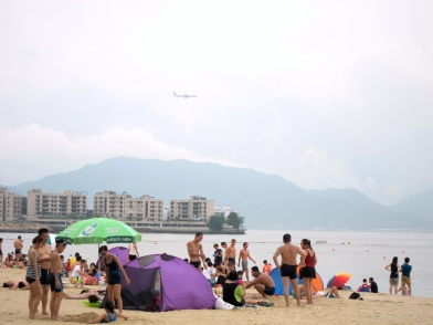 Watch planes land from the beach...sorta.